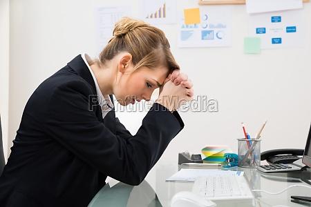 upset businesswoman in office