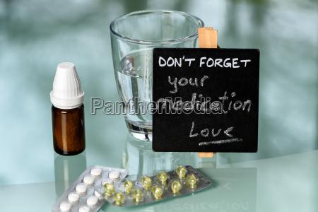 medication reminder on glas table