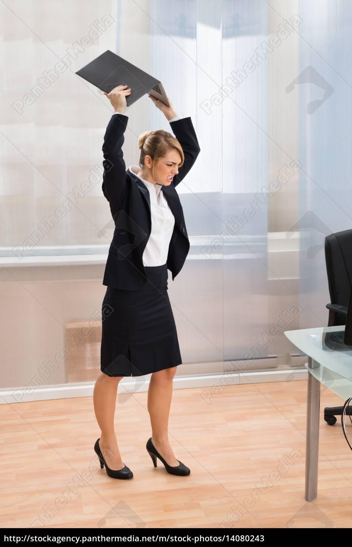 businesswoman, in, rage, throwing, laptop - 14080243