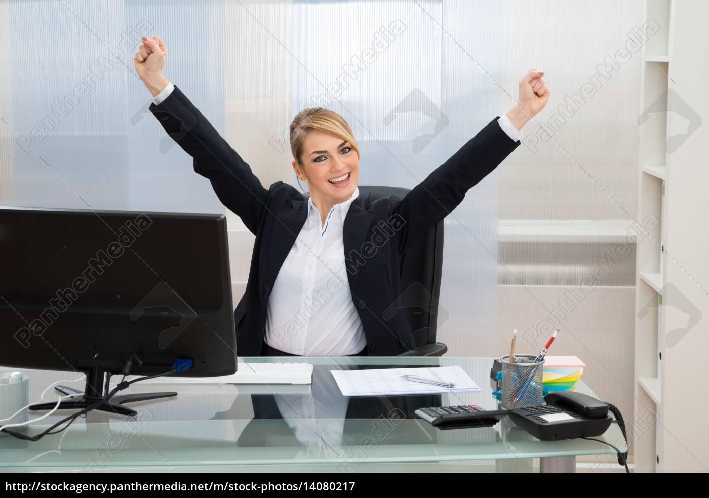 businesswoman, raising, hands, in, office - 14080217