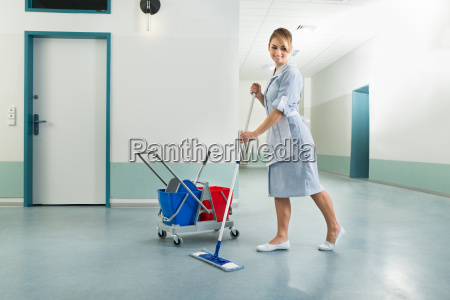 happy, female, janitor, holding, mop - 14080077