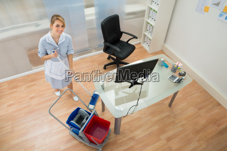 happy, maid, with, mop, in, office - 14080053