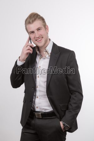 young, businessman, talking, on, the, phone - 14082283