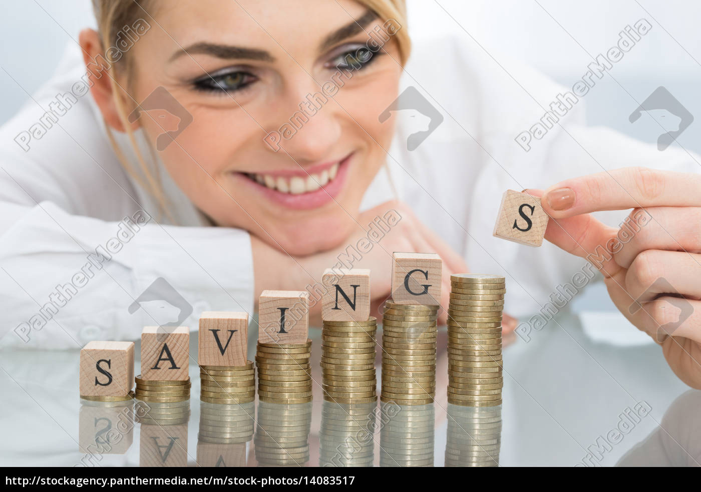 businesswoman, with, savings, blocks, on, coins - 14083517