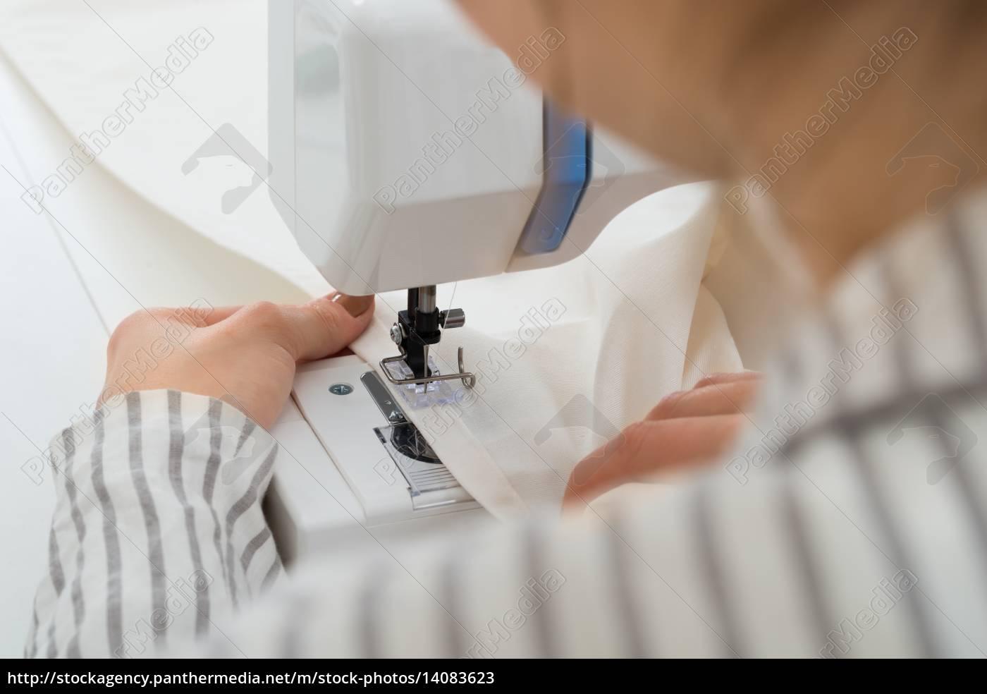 close-up, on, woman, stitching, fabric - 14083623