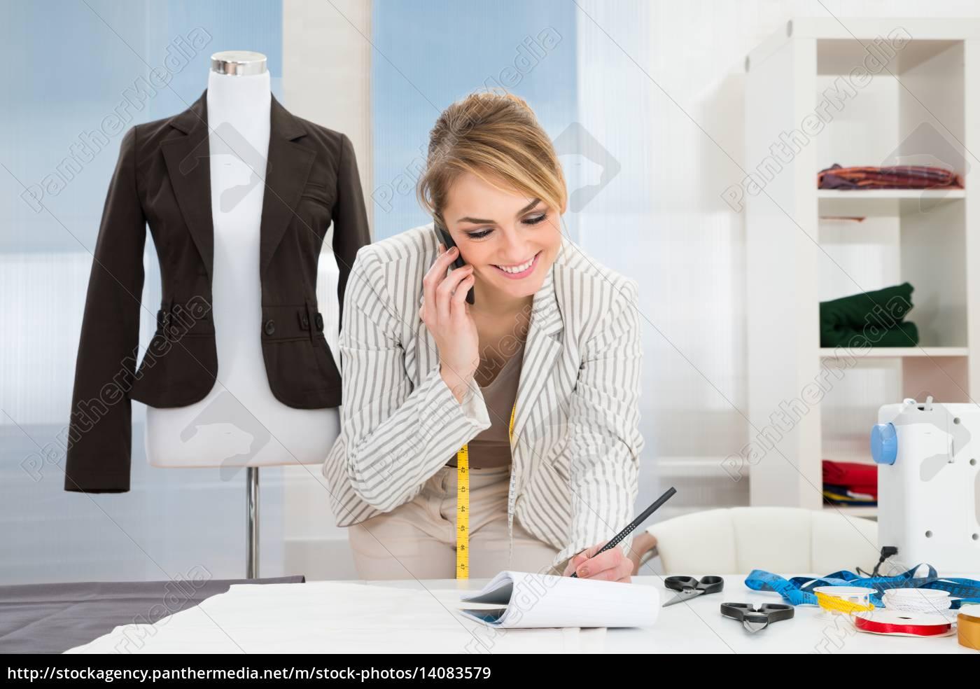 female, fashion, designer, talking, on, cellphone - 14083579