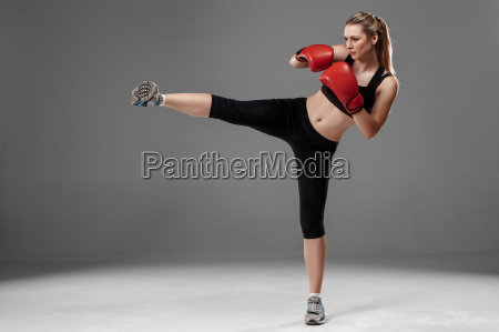 beautiful, woman, is, boxing, on, gray - 14084181