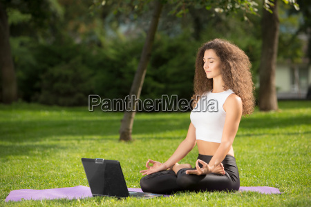 meditating, woman, with, laptop - 14084159