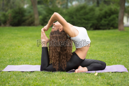 pretty, woman, doing, yoga, exercises - 14084131