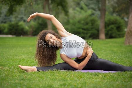 pretty, woman, doing, yoga, exercises - 14084161