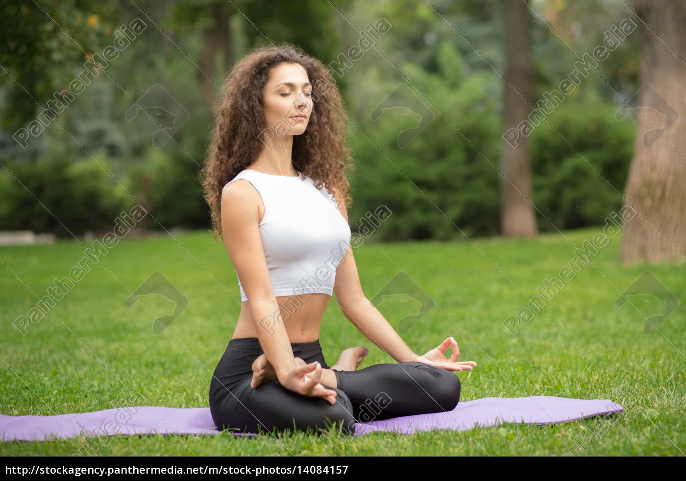 pretty, woman, doing, yoga, meditation, in - 14084157