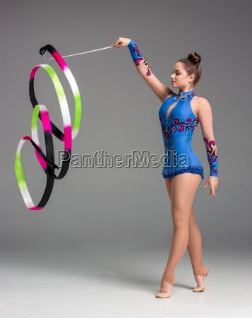 teenager, doing, gymnastics, dance, with, ribbon - 14084227