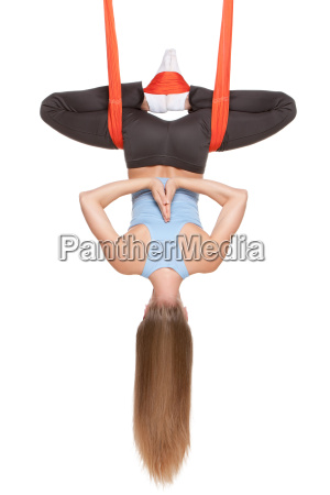 young, woman, doing, anti-gravity, aerial, yoga - 14084003