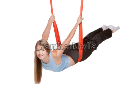 young, woman, doing, anti-gravity, aerial, yoga - 14084019