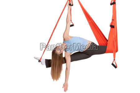 young, woman, doing, anti-gravity, aerial, yoga - 14084033