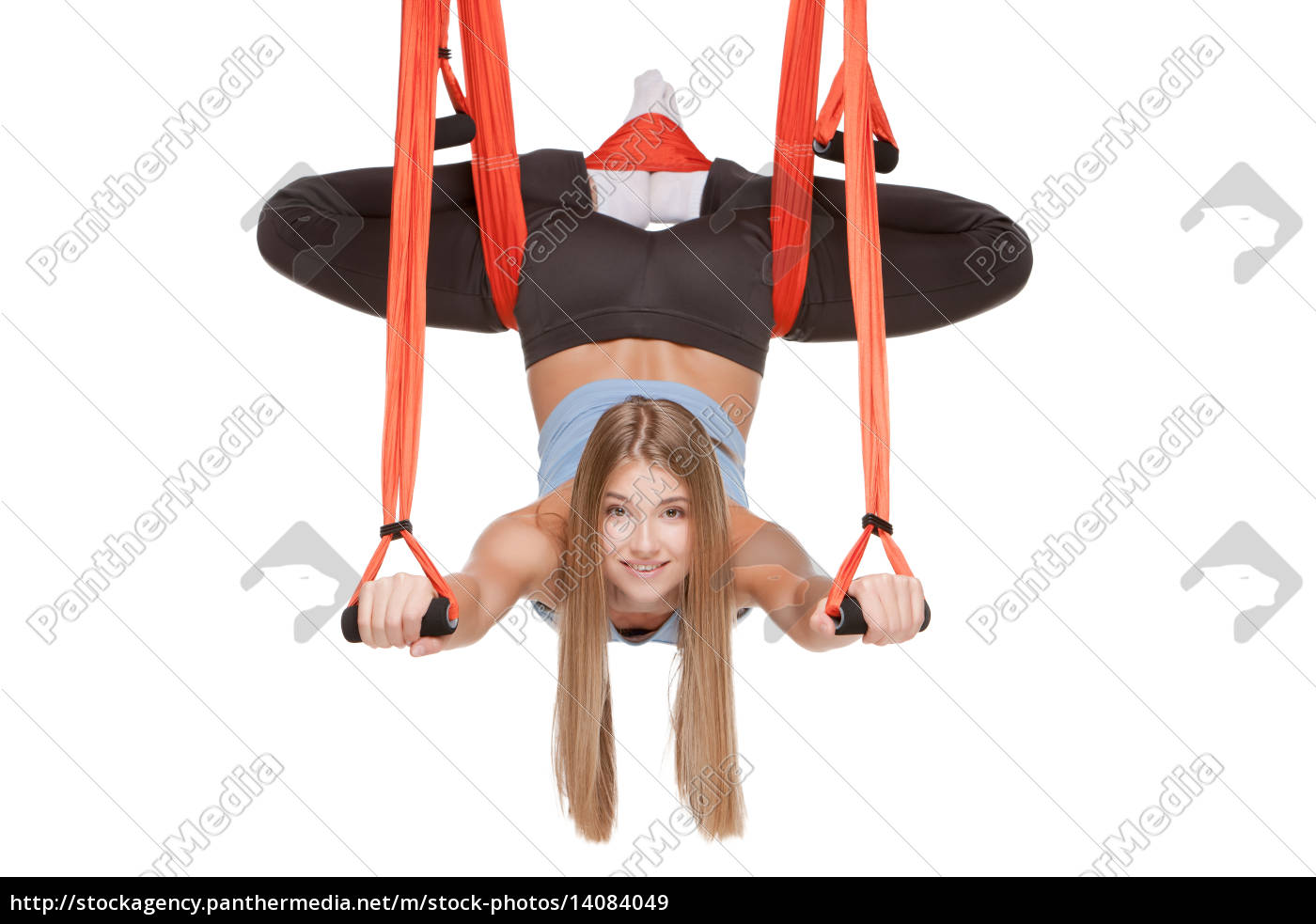 young, woman, making, antigravity, yoga, exercises - 14084049