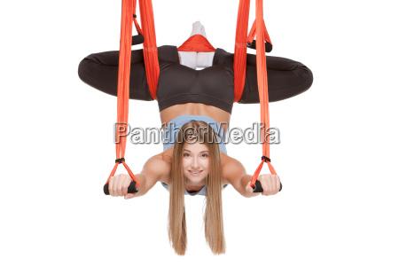 young, woman, making, antigravity, yoga, exercises - 14084049