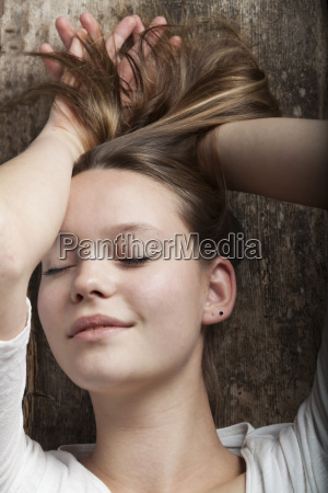 young woman dreaming on a board