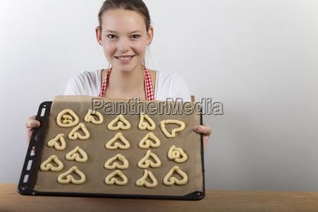 woman bakes cookies