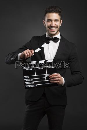 man holding a clapboard