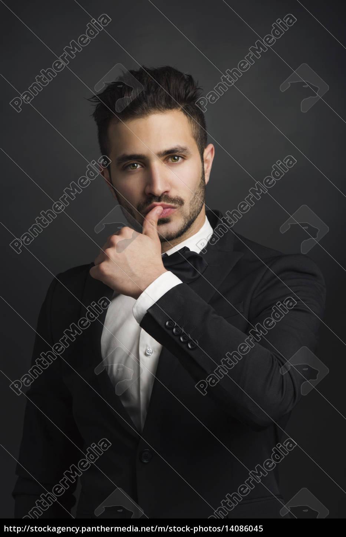 latin, man, wearing, a, tuxedo - 14086045