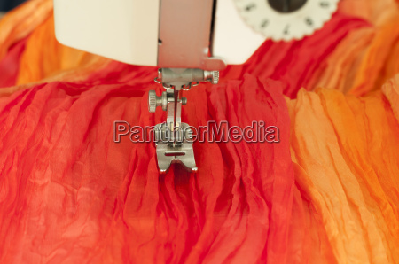 sewing, machine, with, textiles - 14086885