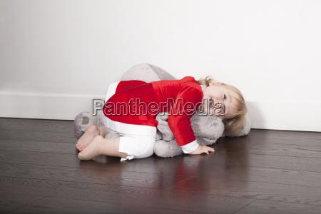 baby santa claus embraced plush doll