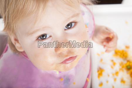 looking baby eating