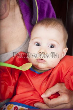 surprised baby eating