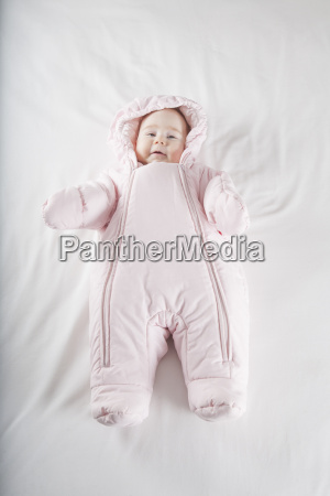 pink, snowsuit, baby, on, bed - 14089889