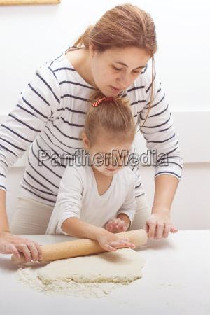teamwork kneading dough