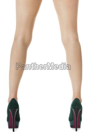 attractive female legs with green stilettos