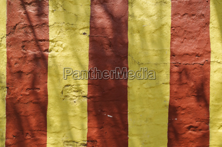 wall with red and yellow stripes