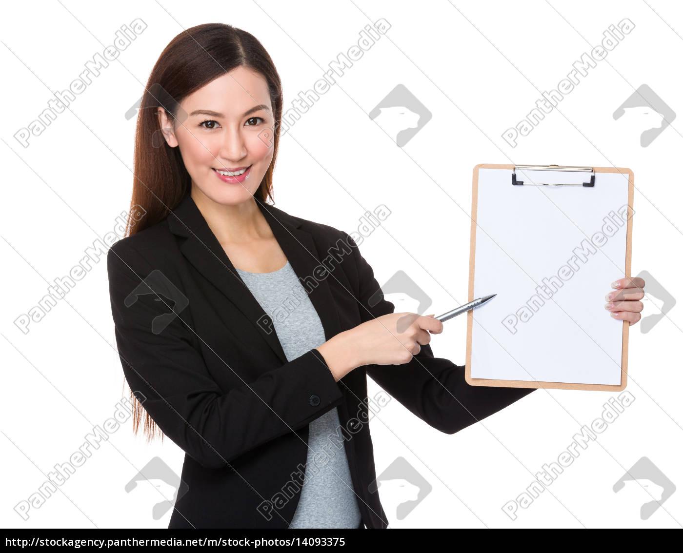 businesswoman, pen, point, to, clipboard - 14093375