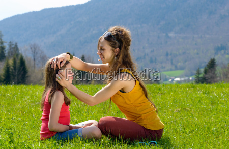 mom plays with her daughter in