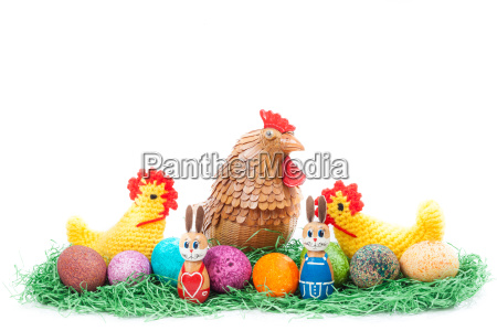 colorful easter nest with chick hen