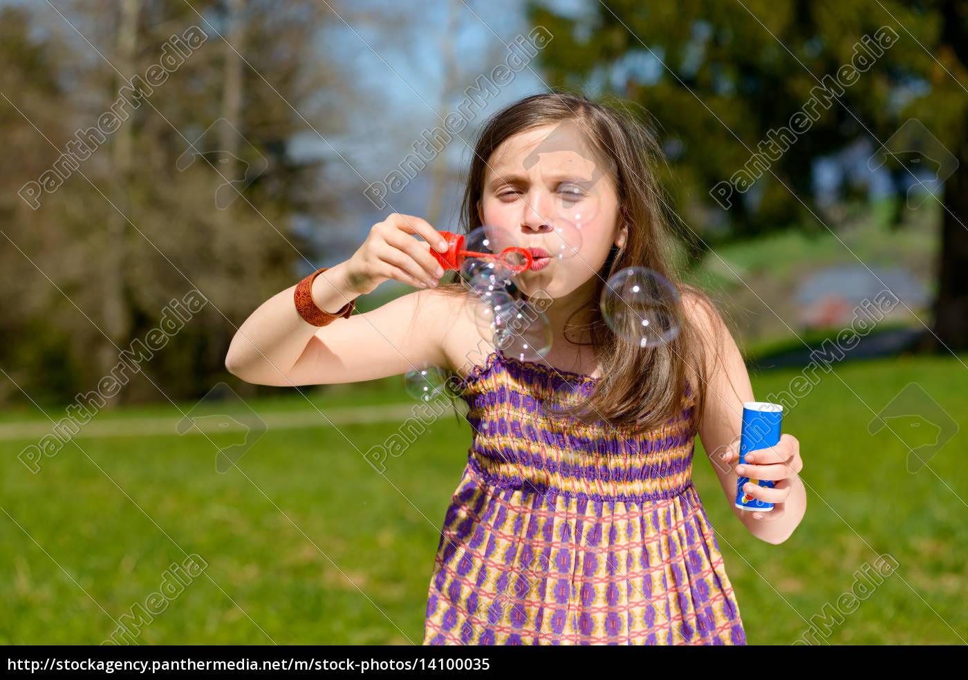 a, little, girl, making, soap, bubbles - 14100035