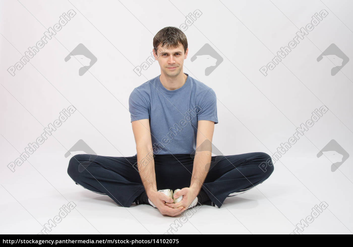 athlete, sitting, holding, hands, your, feet - 14102075