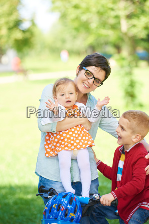 happy, young, family, in, park - 14104895