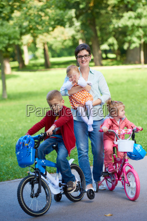 happy, young, family, in, park - 14104949