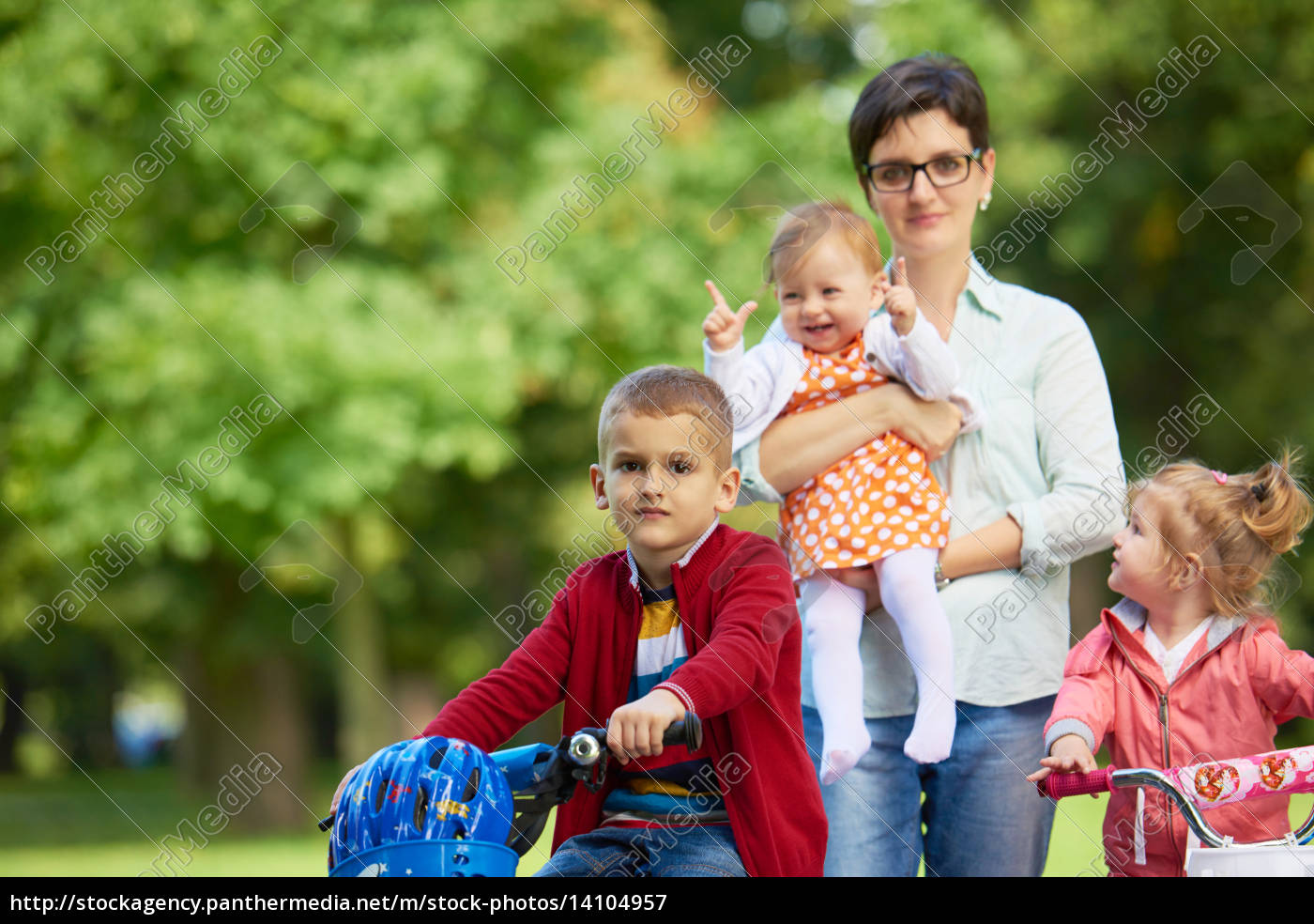 happy, young, family, in, park - 14104957