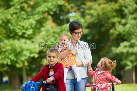 happy, young, family, in, park - 14104961