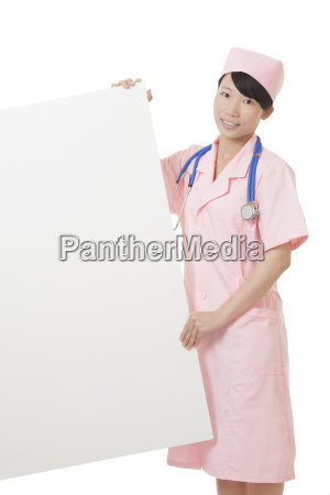 chinese nurse holding a white sign
