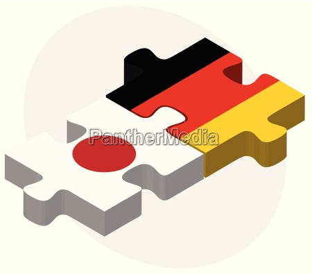 japan and germany flags in puzzle