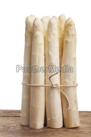 raw asparagus bundle on wood