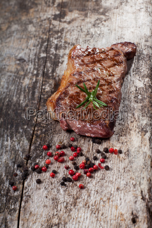 grilled steak on a wooden board