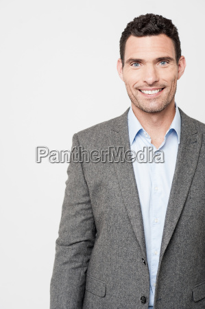 confident businessman smiling