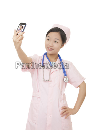 chinese nurse using a cell photo