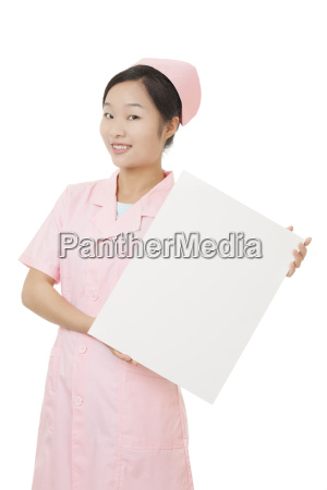 beautiful chinese nurse holding a blank