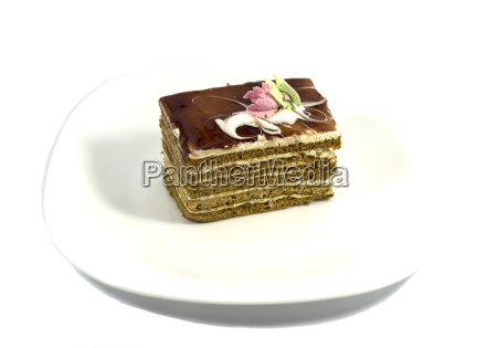 brown cake on a white plate
